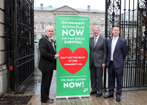 From left: Ciaran McEntee, President, Ned O'Hara, general secrretary and Sean Martin, treasurer, of the Irish Postmasters Union at Leinster House yesterday. Photo: Tom Burke