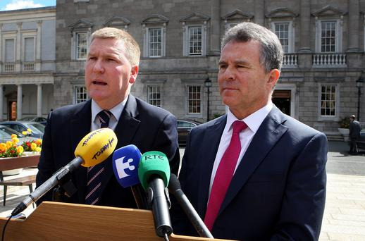 Fianna Fáil's Michael McGrath and Sean Fleming speaking to the media at Leinster House yesterday