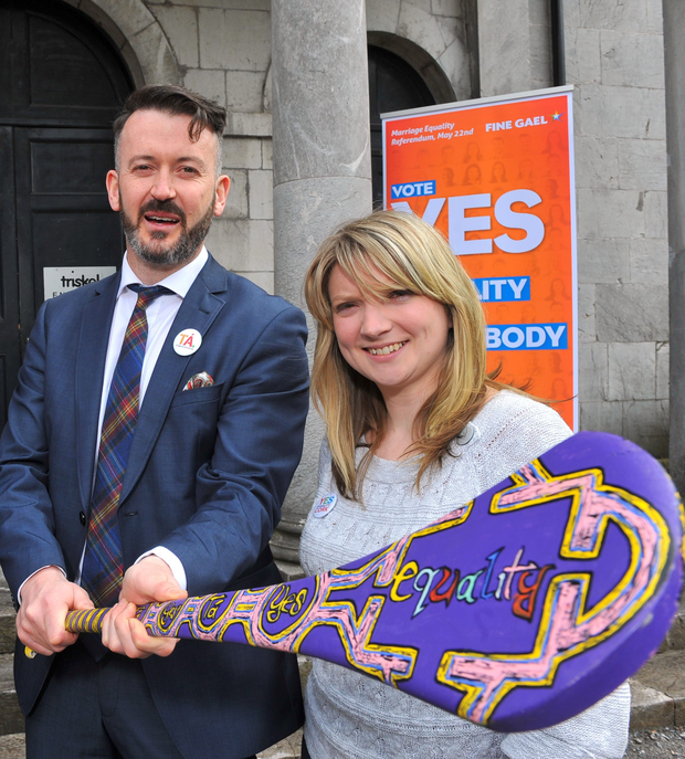 Hurling great Donal Óg Cusack and 'Yes' campaign advocate Rebecca Murphy with a specially designed hurley by John Flynn from Macroom, Co Cork