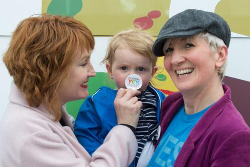 Couple Moninne Griffith and Clodagh Robinson with their daughter Edie at the Yes Equality National Bus Tour in Dún Laoghaire