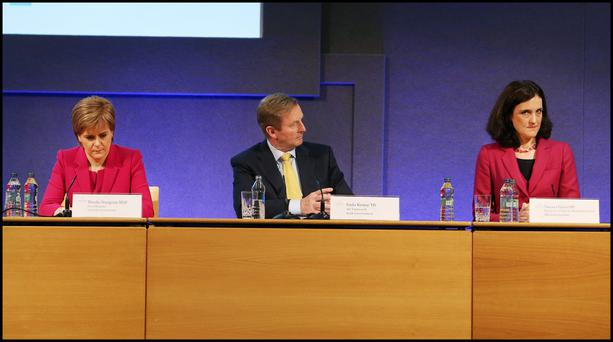 Scottish First Minister Nicola Sturgeon, Taoiseach Enda Kenny and Northern Ireland Secretary of State Theresa Villiers at the British-Irish Council in Dublin. Photo: Steve Humphreys