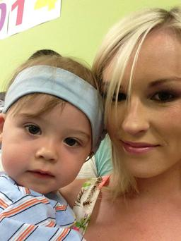 Josh Butler (2) with his mum Chloe. Josh undergoes pioneering ear surgery in Italy tomorrow but his family have accused the HSE of reneging on a pledge to meet the costs of the operation