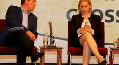 Lucinda Creighton checks her phone while onstage with Noel Dempsey prior to their guest appearance at the MacGill Summer School