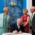President Michael D Higgins and Sabina with Wendy and Colin Parry at the Tim Parry Johnathan Ball Foundation for Peace Centre in Warrington yesterday