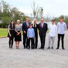Taoiseach Enda Kenny with the Cassidy-Walsh family outside Lissadell House yesterday