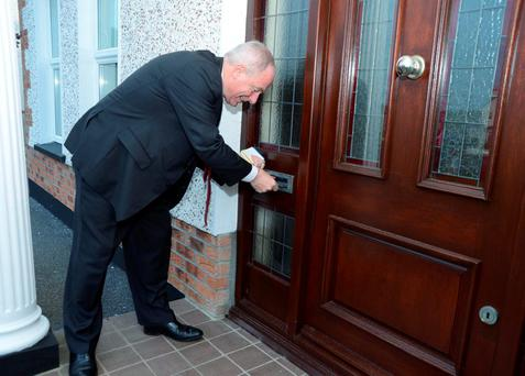 ''No one at home'' Michael ring pops his card through a letter box