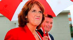 Tanaiste Joan Burton and Environment Minister Alan Kelly: Ms Burton has defended state 'investment' in the free travel scheme