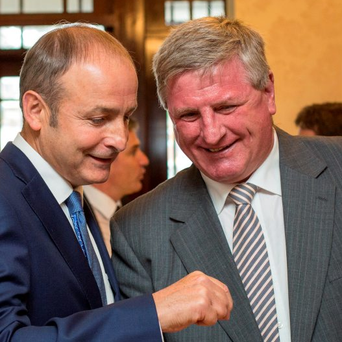 Fianna Fáil leader Micheál Martin swaps a story with Bobby Aylward at the start of the Fianna Fáil think-in