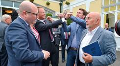 Minister of State Ged Nash talks to Ruairi Quinn as TDs Arthur Spring and Aodhan O Riordain share some banter behind them, at the Labour think-in at the Glenview Hotel, Co Wicklow