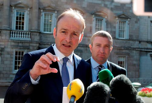 Fianna Fail leader Micheal Martin,TD and Niall Collins,TD, Justice spokesperson meet the media ahead of the no confidence debate on Taoiseach Enda Kenny, TD at Leinster House yesterday