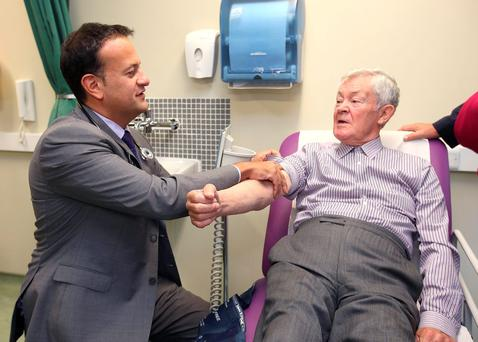 Health Minister Leo Varadkar takes the blood pressure of Paddy Tyndall from Skerries at the launch of the new diabetes programme at Thomas Court Primary Care Centre in Dublin