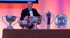 Taoiseach Enda Kenny with the silverware won by the Dublin footballers at last night's Dublin Chamber of Commerce annual dinner in the Convention Centre, Dublin
