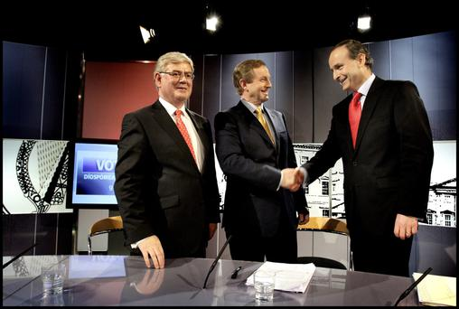 Two's company: Enda Kenny and Micheal Martin shake hands as former Labour Leader Eamon Gilmore stands by.