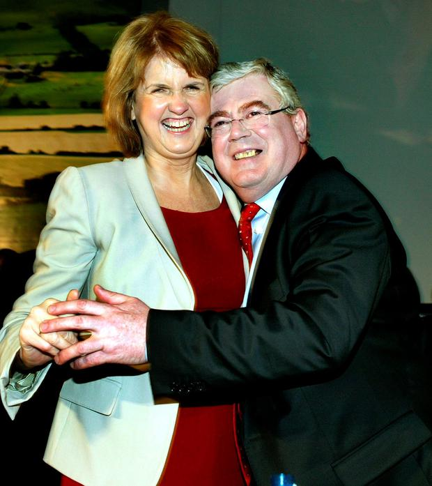 In his memoir, Eamon Gilmore reveals his tempestuous relationship with Joan Burton, pictured above with Mr Gilmore at a Labour conference in 2011