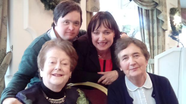 Fiona O'Loughlin, with her brother Cathal, mother Mary (right), and Fianna Fáil's Mary O'Rourke (left) at a function to promote UN Day for People with Disabilities on Thursday