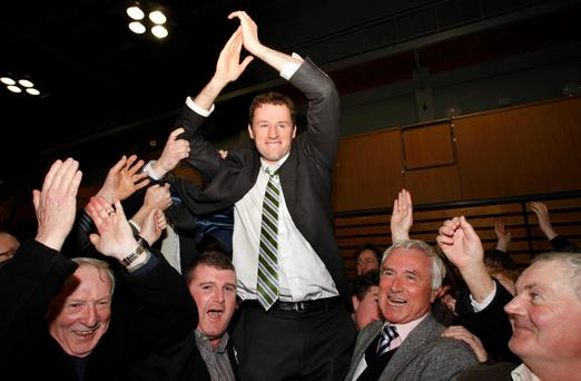 Cllr John O'Donnell lifting Fianna Fáil's Charlie McConalogue following his election to the Dail in 2011