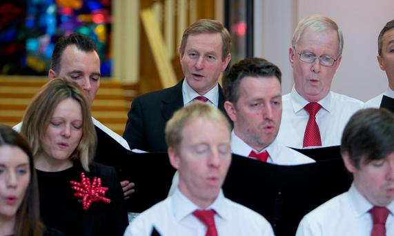 Taoiseach Enda Kenny joins the staff choir in the Department of the Taoiseach during the annual lunchtime recital of Christmas carols at Government Buildings in Dublin. Photo: Gareth Chaney, Collins