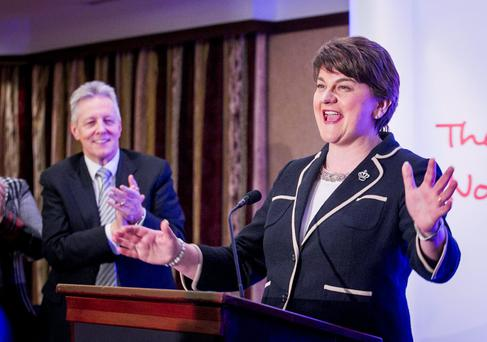 Peter Robinson watches as Finance Minister Arlene Foster reacts after she was elected as leader of the DUP. Photo: Liam McBurney/PA Wire