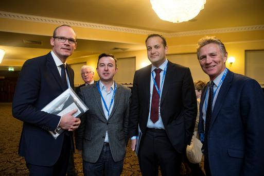 Defence Minister Simon Coveney, Brian Hayes, director for elections, Health Minister Leo Varadkar and Senator Eamonn Coghlan at the opening of the Fine Gael Ard Fheis in the Citywest Hotel in Dublin last night. Photo: Arthur Carron