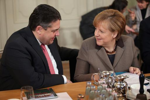 Grand coalition: Germany's SPD leader Sigmar Gabriel with Angela Merkel.