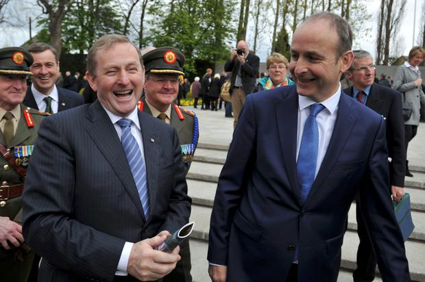 Taoiseach Enda Kenny laughs with Fianna Fáil leader Micheal Martin at the 1916 Arbour Hill Commemoration. Photo: Clodagh Kilcoyne