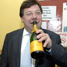 Brian Cowen celebrates with champagne after winning his seat in the Offaly/Laois election count in May 2007 Photo: James Flynn/APX