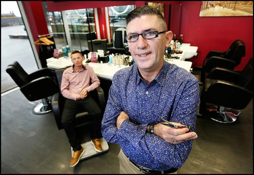 Technical details: Alan Austin and Gary Browne, who are proprietors of Grand Barbers at Altro Vitro on the Grand Canal Dock, Dublin. Photo: Steve Humphreys