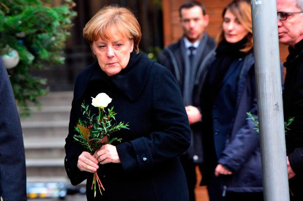 German chancellor Angela Merkel arrives at a Christmas market in Berlin one day after a truck ran into the crowded Christmas market in Berlin. Photo: AP