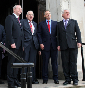 THE HISTORY BOYS: Stormont Castle, Tuesday May 8, 2007, when the Rev Ian Paisley and Martin McGuinness were sworn in as First and Deputy First Ministers of Northern Ireland. From left, Martin McGuinness Ian Paisley, former British PM Tony Blair and former Taoiseach Bertie Ahern share a smile. Photo: Paul Faith/PA
