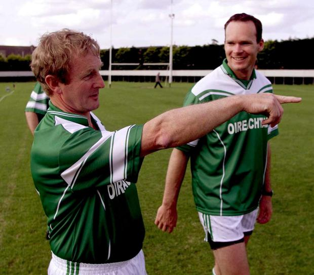 Enda Kenny and Simon Coveney discuss tactics before a friendly Gaelic football match between the Oireachtas and the PSNI in June 2003. Photo: Martin Nolan