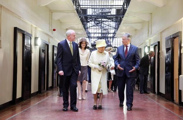 Mr McGuinness with Queen Elizabeth and Peter Robinson