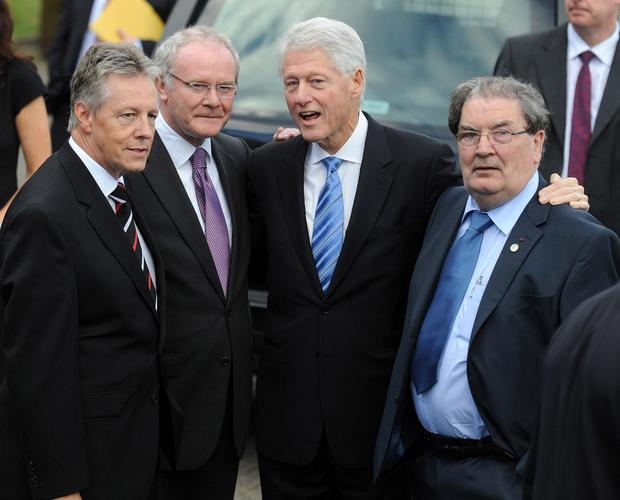 Martin McGuinness with Peter Robinson (left), Bill Clinton (to his right) and David Hume (far right) in 2010
