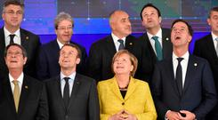 Some of the EU leaders, including Taoiseach Leo Varadkar, back row, right, take part in a photo-call after a meeting on the first day of the European summit