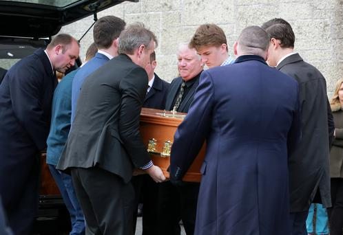 Family and friends carry the coffin of Frank Murray during his removal to The Church of Our Lady of Perpetual Succour in Foxrock