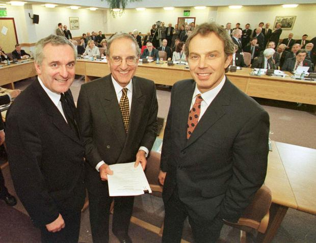 Sign of the times: Former Taoiseach Bertie Ahern, former US Senator George Mitchell and former British Prime Minister Tony Blair after the signing of The Good Friday Agreement set Northern Ireland in 1998.