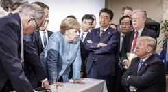 Stars and gripes: German Chancellor Angela Merkel talks to Donald Trump at the G7 summit in Canada in June