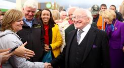 Walkabout: President Michael D Higgins meets well-wishers. Photo: Gerry Mooney
