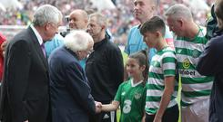 Tribute: President Michael D Higgins meets Liam Miller's children, Belle and Kory before the match in Cork yesterday. Photo: Damien Eagers
