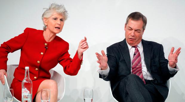 Nigel Farage (R) reacts as he speaks with Italian-Swedish MEP Anna Maria Corazza Bildt during a panel discussion at a conference on Brexit, at the Saatchi Gallery in London yesterday. Picture: AFP/Getty