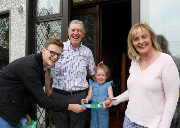 Albert Dolan canvassing at the door step of Sean and Moira Martyn with their grand-daughter Robyn Kelly in Monivea, Athenry. Photograph: Hany Marzouk