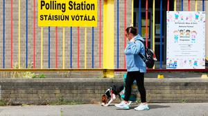 Action stations: A woman walks a dog past a polling station at St Patrick's Girls' National School, Ringsend, Dublin, ahead of the Dublin Bay South by-election to fill the seat vacated by former Housing Minister Eoghan Murphy. Photo: Brian Lawless/PA Wire