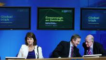 Enda Kenny and Charlie Flanagan chatting to each other alongside Joan Burton at the launch of 'Global Irish: Ireland's Diaspora Policy' at Government Buildings yesterday. Photo:  Steve Humphreys