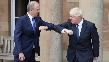 Taoiseach Micheal Martin and British Prime Minister Boris Johnson greet each other with an elbow bump at Hillsborough Castle, in Belfast, last August Brian Lawless/Pool via Reuters