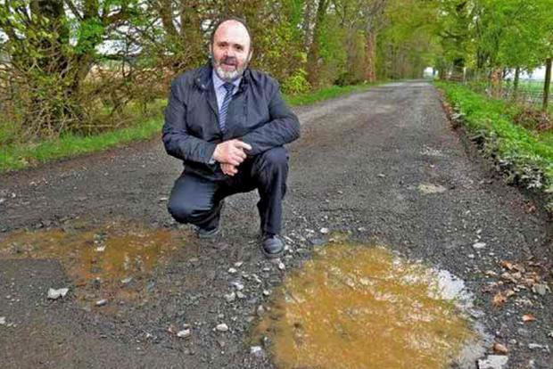 An image from the Sinn Féin toolkit showing how                   press photos should be staged - with no pointing at                   potholes