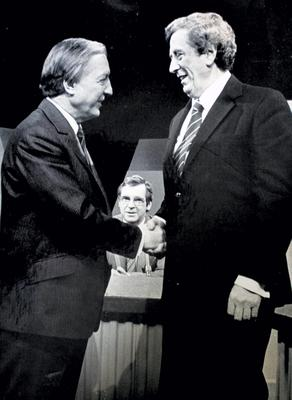 Charlie Haughey and Dr, Garret FitzGerald shake hands befored an RTE TV Seven Days  programme in centre is presenter Brian Farrell