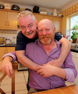 Gay couple Joseph Bowlby and his partner Donal Traynor at home