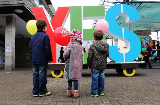 Three children admire the giant 'Yes' sign in Cavan Market Square yesterday as part of the 'Yes' vote campaign 'Get it Across the Line'