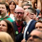 People gather at Dublin Castle to hear the result of the same-sex marriage referendum
