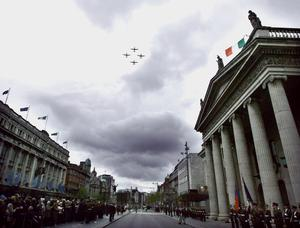 Solders on parade stand at attenton outside the GPO in Dublin to mark the 96th Easter 1916 Commemoration Ceremony as Air Corps fly over. Photo: Sam Boal/Photocall Ireland