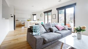 Open plan living room kitchen contemporary home with grey sofa